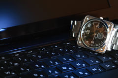 Watch On Computer Keyboard Royalty Free Stock Photo