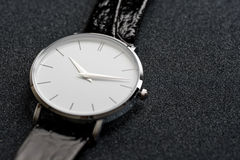 Watch on dark background Stock Photo
