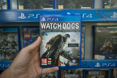 Watch Dogs. Bratislava, Slovakia, circa april 2017: Man holding Watch Dogs videogame on Sony Playstation 4 console in store Royalty Free Stock Photo