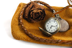 A watch and a dry rose Royalty Free Stock Images