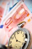 Watch on the euro banknotes. Royalty Free Stock Image
