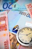 Watch on the euro banknotes. Royalty Free Stock Photography