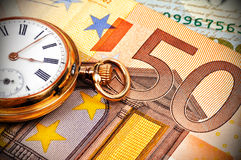 Watch and euro bills Royalty Free Stock Photo