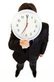 watch för holding för affärsmanframsidaframdel fotografering för bildbyråer
