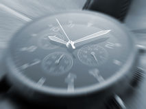 Watch face with zoom effect. Closeup of watch face with zoom effect focused on hands Royalty Free Stock Photo