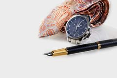 Watch, fountain pen and bright tie against white background. Happy Father& x27;s Day concept image or present card. Copy space. Stock Photo