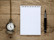 Watch, fountain pen and notebook Stock Photo