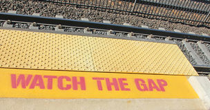 Watch The Gap. Sign warning railroad passengers to Stock Photos