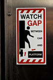 Watch gap between car and platform royalty free stock photo