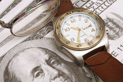 Watch glasses & money. Shot of watch, pair of glasses and money Royalty Free Stock Photo