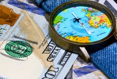 Watch with global map on cash money. World map clock. Worldwide business concept. Cash banknotes background. Global business. Worldwide business travel stock images