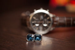 Watch and groom's cuff links Royalty Free Stock Images