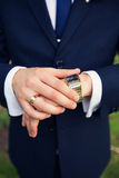 Watch on the groom's hand Stock Image