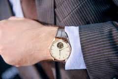 Watch on the hand of man Stock Images