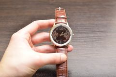 Watch in hands Royalty Free Stock Photography