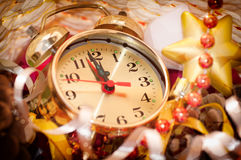 Watch hands by 12 hours and Christmas toys Royalty Free Stock Image