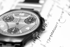 Watch on handwrite paper Royalty Free Stock Photo