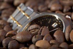 Watch in a heap coffee grains Stock Photography