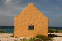 Watch the horizon. Bright yellow slavehut on Bonaire Stock Photo