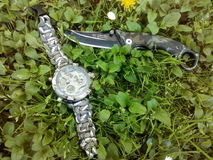 Watch and knife Stock Photo