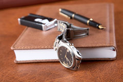Watch lighter  pen and an organizer Stock Photography
