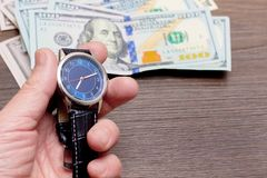 The watch is lying on dollars. Time to earn money. Time is money. Crcy space_. The watch is lying on dollars. Time to earn money. Time is money. Crcy space royalty free stock images