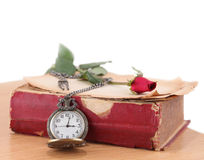watch lying on old book  Royalty Free Stock Image