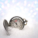 Watch lying in the snow Stock Image