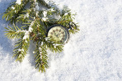 Watch lying in the snow before  new year Royalty Free Stock Photos