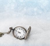 Watch lying in the snow before the new year Stock Photography