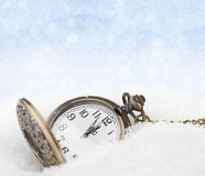 Watch lying in the snow before the new year Royalty Free Stock Image