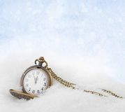 Watch lying in the snow before the new year Royalty Free Stock Photo