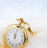Watch lying in the snow before the new year Royalty Free Stock Photography