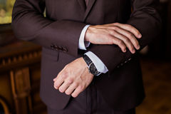 Watch on a man's hand, the fees of the groom, wedding preparation Royalty Free Stock Image