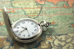 Watch and map. Old pocket watch on a map Stock Photos