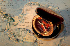 Watch on map 4. Pocketwatch on map - showing different time zones Stock Photo