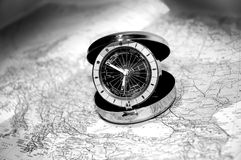 Watch on map b&w 5. Pocketwatch on map - showing different timezones royalty free stock images