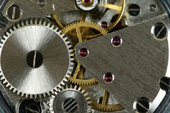 Watch mechanism. Small watch mechanism close-up. Steel clock works royalty free stock photography