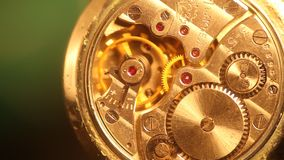 Watch mechanism macro with gold cogwheels stock video