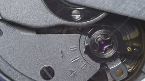 Watch mechanism macro. Movement of the clockwork pendulum stock video footage