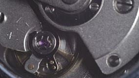 Watch mechanism macro. Movement of the clockwork pendulum stock video