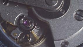 Watch mechanism macro. Movement of the clockwork pendulum stock footage