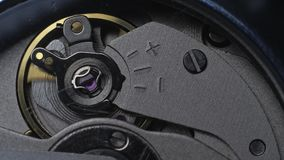 Watch mechanism macro. Slow motion 180fps. Movement of the clockwork pendulum stock footage