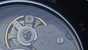 Watch mechanism macro. Slow motion 180fps. Movement of the clockwork pendulum stock video