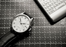 Watch and mobile phone Stock Image