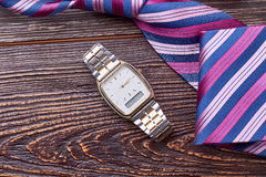 Watch near striped tie. Royalty Free Stock Images