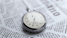 Watch on newspaper. Video showing close-up stopwatch in work stock video
