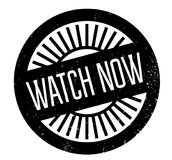 Watch Now rubber stamp. Grunge design with dust scratches. Effects can be easily removed for a clean, crisp look. Color is easily changed Royalty Free Stock Photos