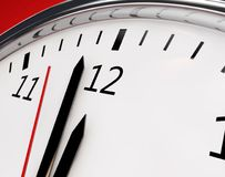 Watch 12 o`clock. Clock about to show 12 o`clock - New Year / Running out of time Royalty Free Stock Photo