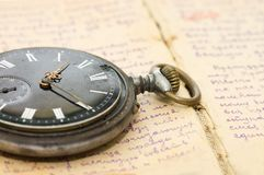 Watch on an old notebook with the text Royalty Free Stock Images